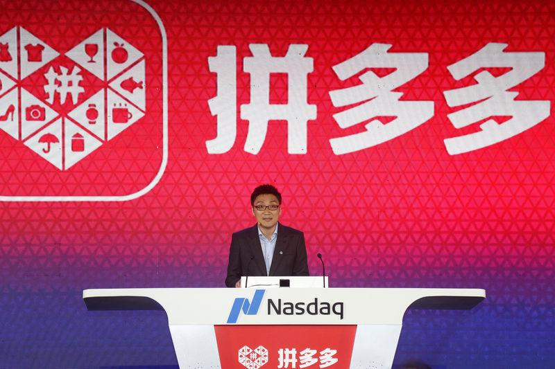 Colin Huang, founder and CEO of the online group discounter Pinduoduo, speaks during the company's stock trading debut at the Nasdaq Stock Market in New York, during an event in Shanghai