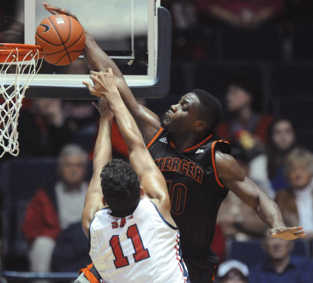 Mercer's Ike Nwamu (10) misses on a dunk attempt against Mississippi's Sebastian Saiz (11) during anNCAA college basketball game Sunday, Dec. 22, 2013, in Oxford, Miss. (AP Photo/Oxford Eagle, Bruce Newman)