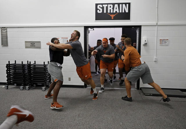Texas Longhorns football players run into their morning workout Wednesday Sept. 4, 2019 in Austin, Tx. ( Photo by Edward A. Ornelas )