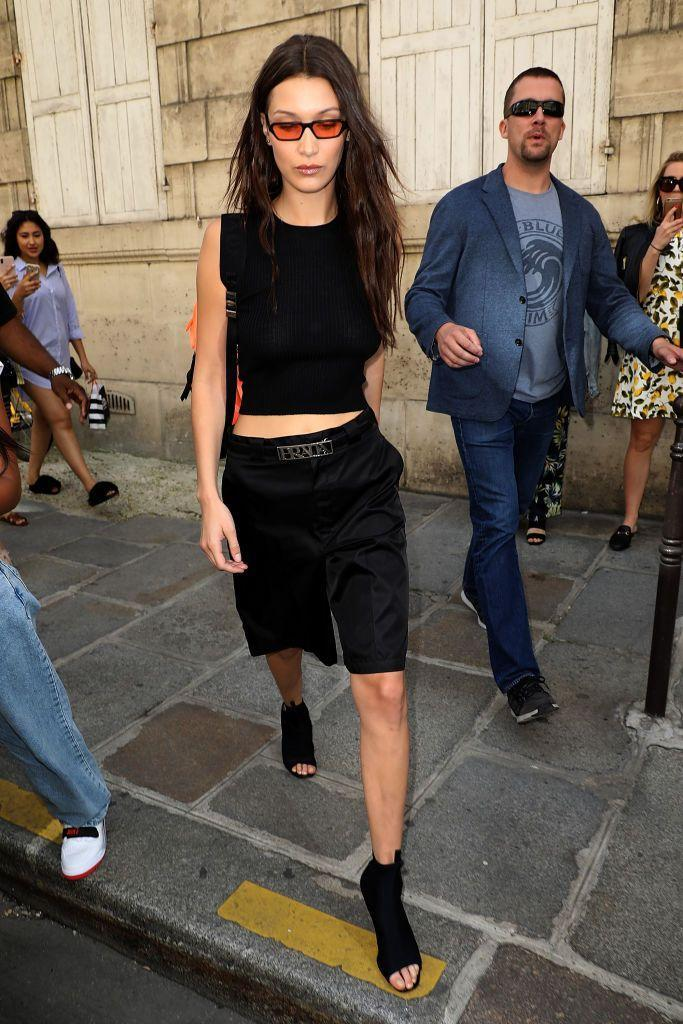 <p>The model went for orange-tinted glasses with a black ensemble to visit the Dior atelier in Paris. </p>