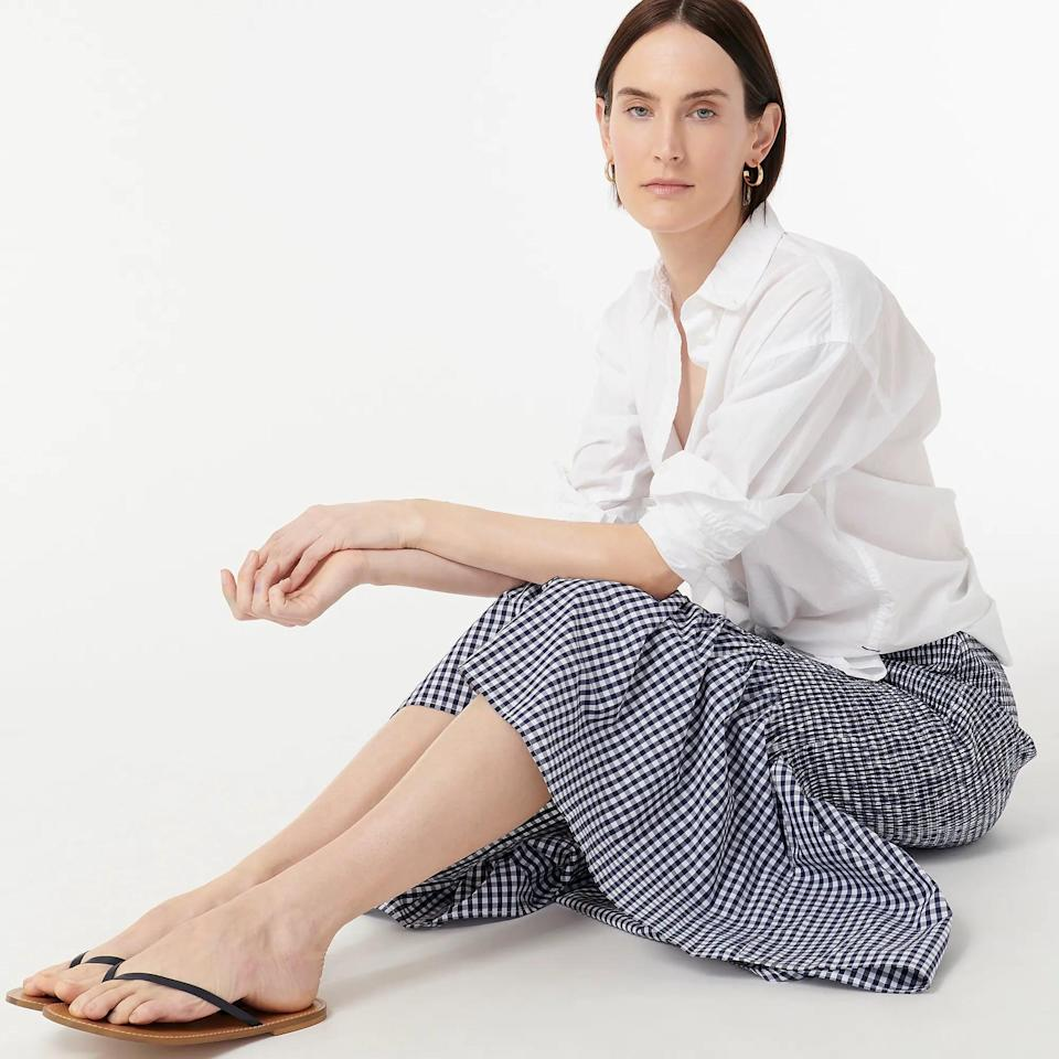<p>This <span>Smocked Midi Skirt</span> ($90, originally $128 (plus extra 60% off with code SALETIME) will get you noticed at the next picnic, thanks to its striking gingham print and subtle dose of color. It's designed for the perfect fit, thanks to the smocked fabric and a flared ruffle hem.</p>