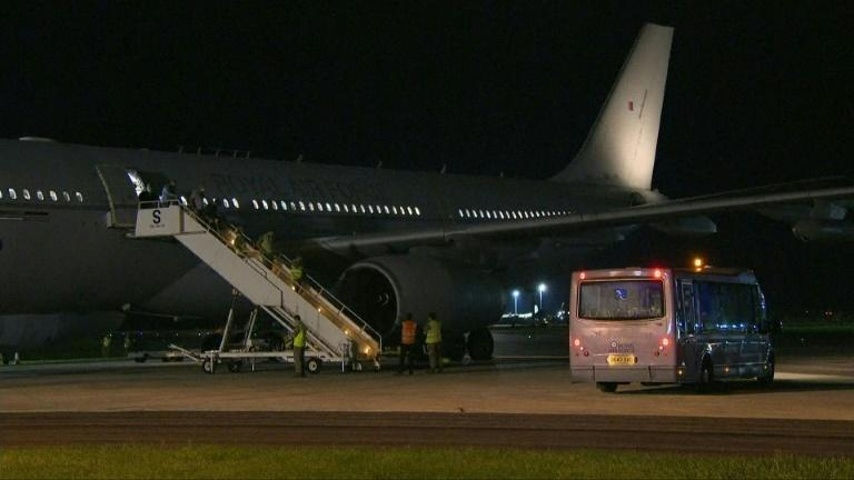 Evacuees from Afghanistan disembark from UK military plane in England