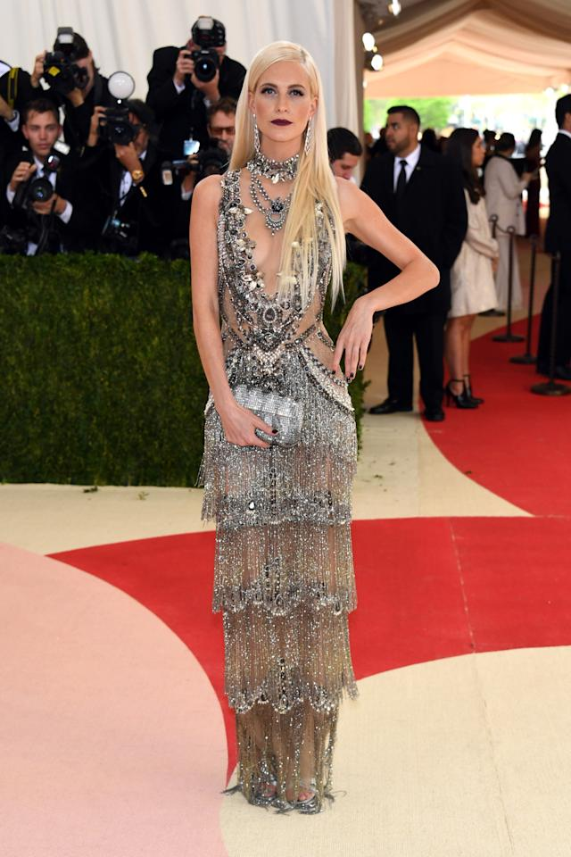 <p>Poppy Delevingne dressed in a sparkly flapper dress, channeling the past instead of the future. <i>(Photo: Getty Images)</i></p>