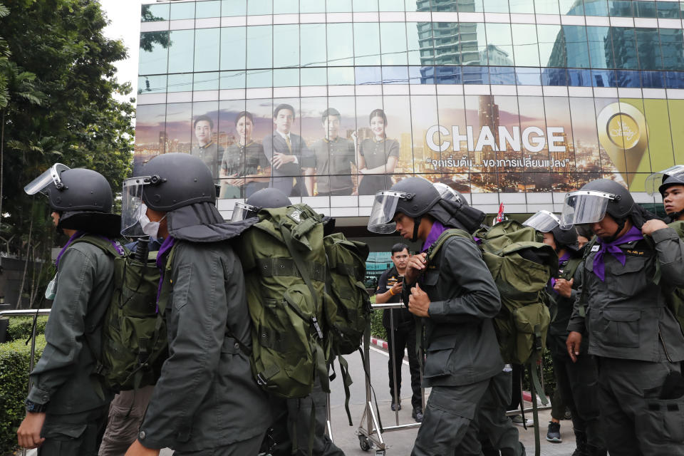 Police arrive outside the German Embassy in central Bangkok, Thailand, Monday, Oct. 26, 2020. Thai royalists gathered outside the embassy to defend pro-democracy protesters' contention that King Maha Vajiralongkorn spends much of his time in Germany conducting Thai political activities. German government officials have recently expressed concern over political activities the king might be conducting on the Germany's soil. (AP Photo/Gemunu Amarasinghe)