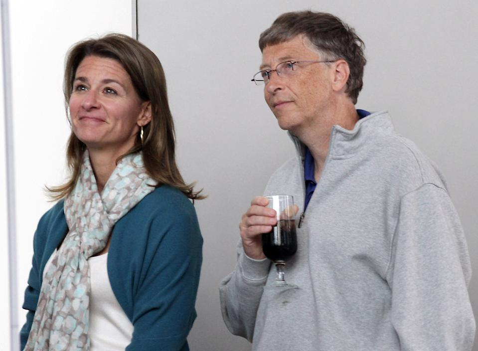 Bill and Melinda Gates listen to remarks during the opening reception of Bill and Melinda Gates Foundation campus in Seattle, Washington, June 2, 2011. REUTERS/Marcus Donner