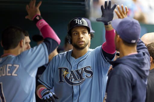 Tampa Bay Rays' James Loney is congratulated on his home run during the eighth inning of an interleague baseball game against the San Diego Padres, Sunday, May 12, 2013, in St. Petersburg, Fla. The Rays won 4-2. (AP Photo/Mike Carlson)