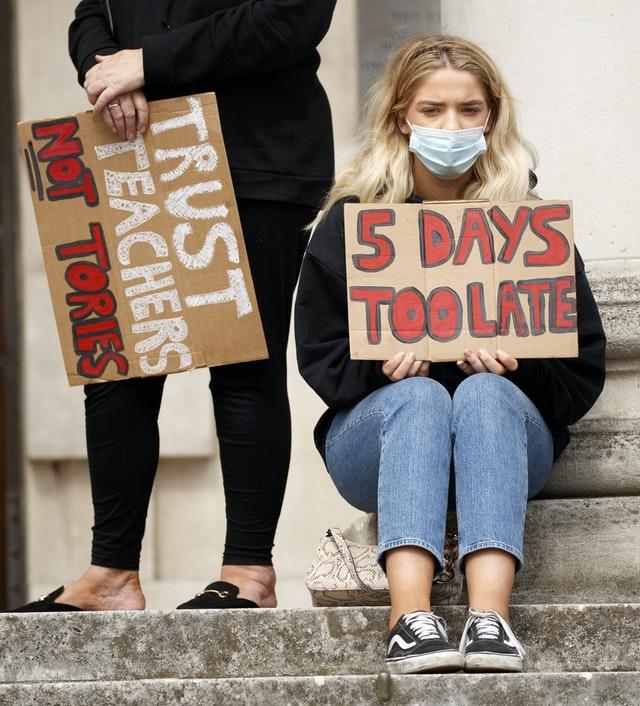 Students take part in a protest in Millennium Square, Leeds
