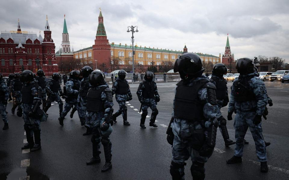 Russian riot police officers block a street near the Kremlin in Moscow - DIMITAR DILKOFF /AFP
