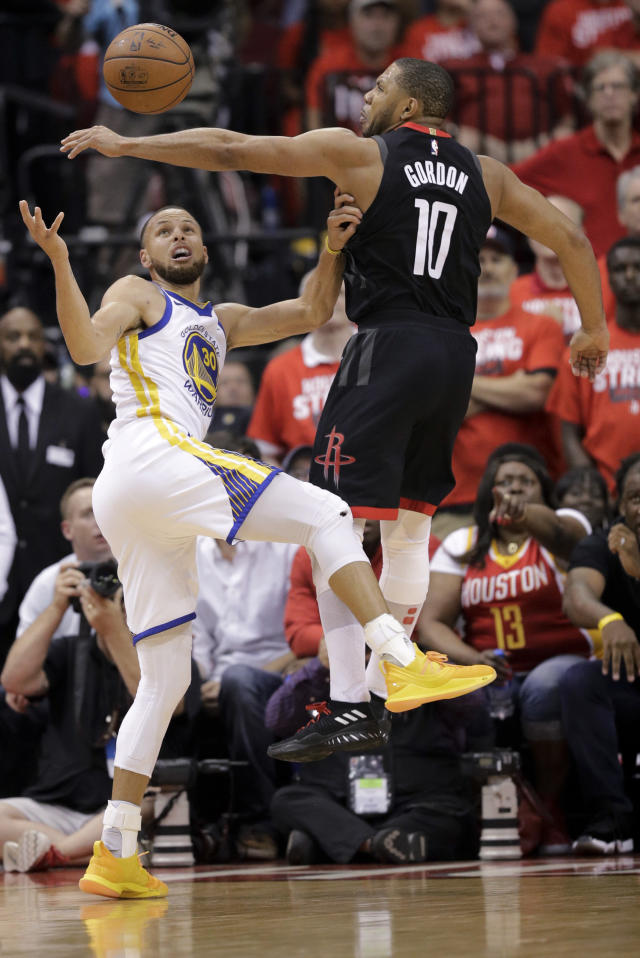 Houston Rockets guard Eric Gordon, right, blocks a shot by Golden State Warriors guard Stephen Curry during the second half in Game 5 of the NBA basketball playoffs Western Conference finals in Houston, Thursday, May 24, 2018. (AP Photo/David J. Phillip)