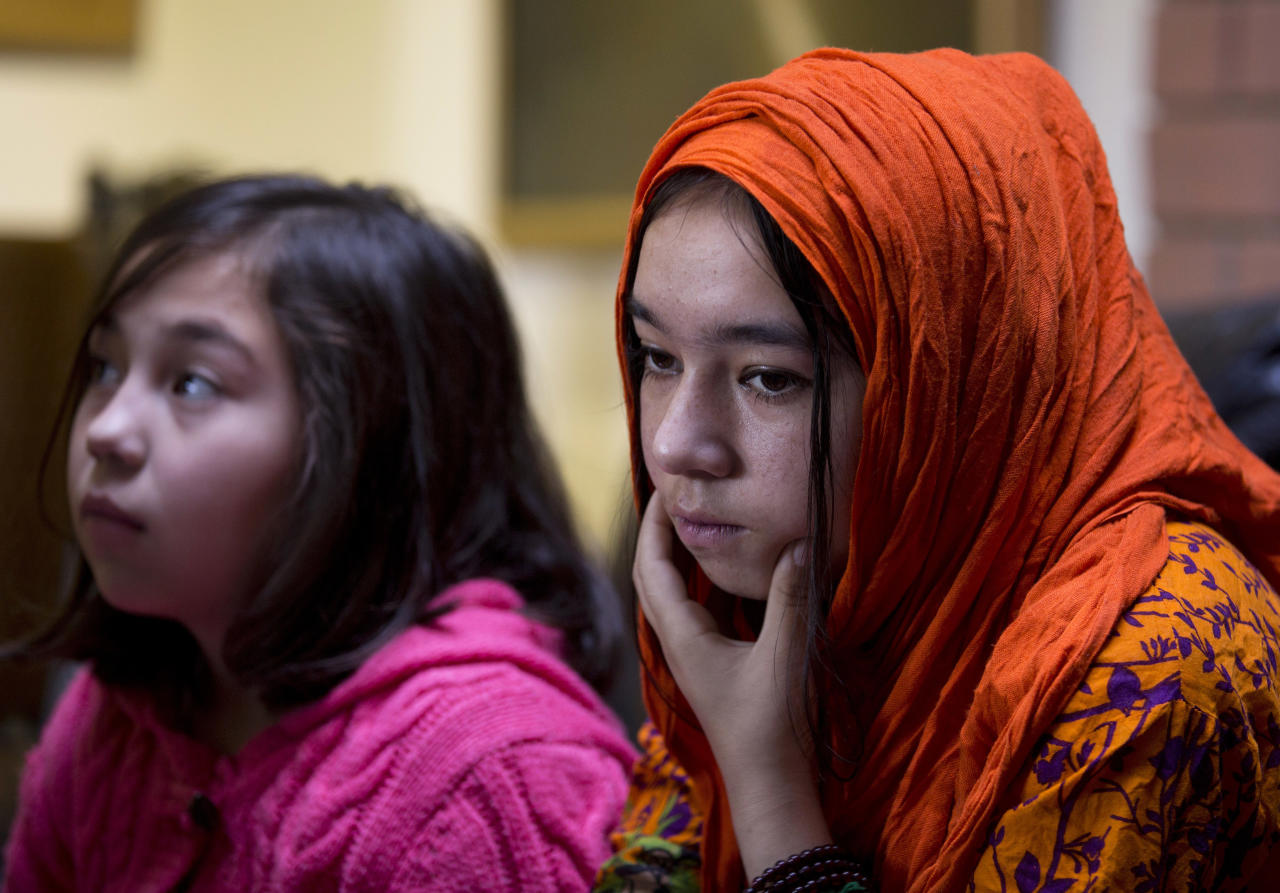 <p> In this Nov. 29, 2018 photo, Shahnaz, 16, right, and Shakeela, 12, daughters of Mir Aman, speak to The Associated Press, in Islamabad, Pakistan. Scores of Pakistani men like Aman, whose Muslim Uighur wives have disappeared into internment camps in China, feel helpless, fighting a wall of silence as they struggle to reunite their families. Political and economic factors, including concerns about losing out on vast Chinese investments, have kept Muslim countries like Pakistan quiet about the plight of their fellow Muslims, being weaned off their faith in so-called re-education camps. (AP Photo/B.K. Bangash) </p>