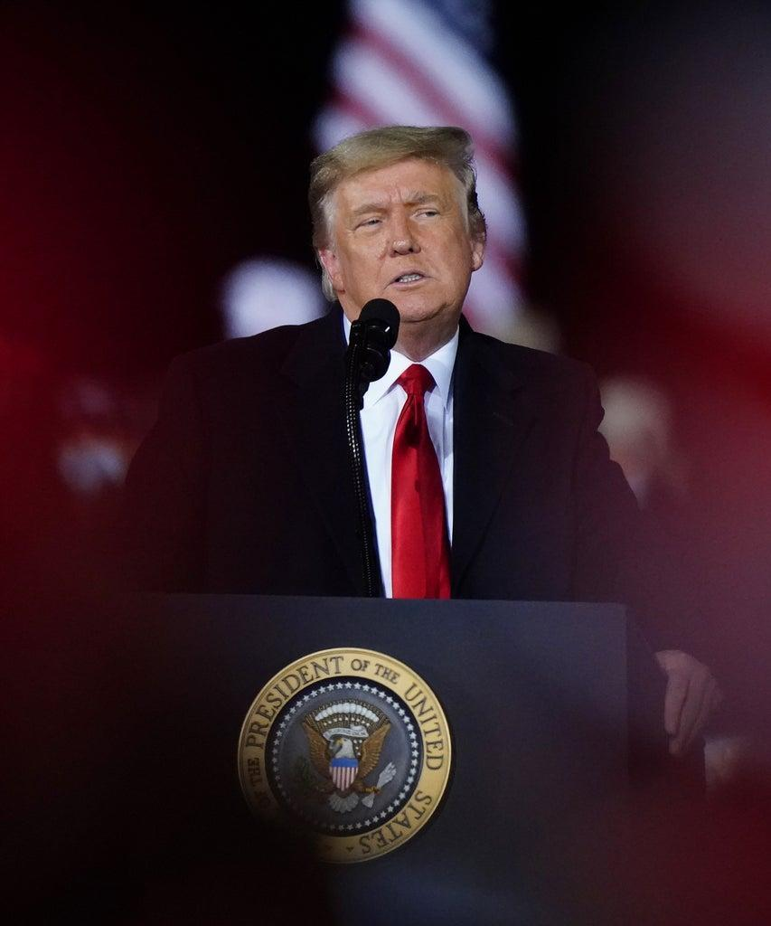 Mandatory Credit: Photo by Brynn Anderson/AP/Shutterstock (11698523h) President Donald Trump speaks at a campaign rally in support of Senate candidates Sen. Kelly Loeffler, R-Ga., and David Perdue in Dalton, Ga Trump, Dalton, United States – 04 Jan 2021