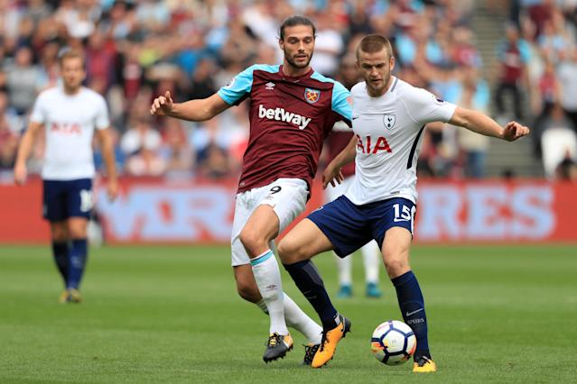 It was not Andy Carroll's (left) day as Tottenham and Eric Dier (right) made things tough for the substitute
