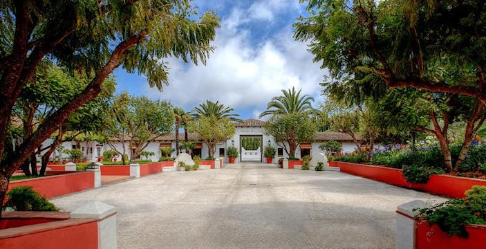 <p>There's no doubt you're entering a grand Andalusian estate when you first arrive at Hacienda de la Paz, but you'll still be surprised by what you'll find inside and down under. (Photo by Steve Brown/Sepia Productions)</p>