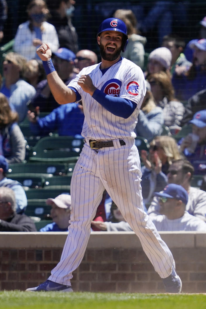 Chicago Cubs' David Bote celebrates after scoring on an RBI single by Zach Davies during the second inning of a baseball game against the Cincinnati Reds in Chicago, Saturday, May 29, 2021. (AP Photo/Nam Y. Huh)