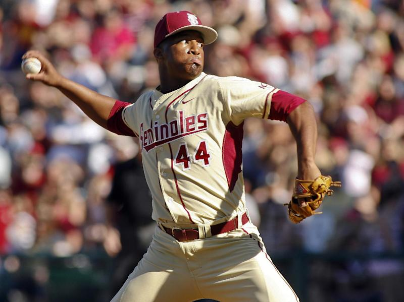 FILE - In this March 2, 2014, file photo, Florida State relief pitcher Jameis Winston throws in the ninth inning of an NCAA collegebaseballgame against Miami in Tallahassee, Fla. The Florida State baseball team has indefinitely suspended Heisman Trophy winner Jameis Winston, who is a relief pitcher for the Seminoles. Baseball coach Mike Martin said in a statement Wednesday, April 30, 2014, that Winston was issued a citation the night before, but he did not give specifics. The Leon County Sheriff's Office has declined comment. (AP Photo/Phil Sears, File)