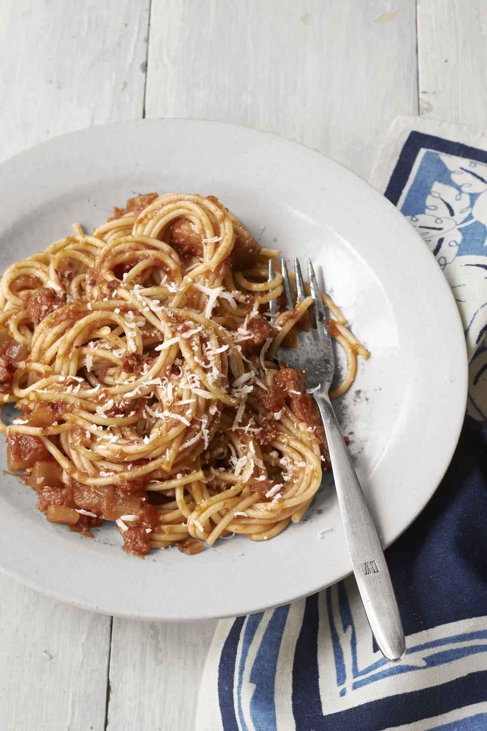 """<p>Traditional pasta gets an upgrade from Jenn Louis, chef-owner of <a href=""""http://www.lincolnpdx.com/"""" rel=""""nofollow noopener"""" target=""""_blank"""" data-ylk=""""slk:Lincoln Restaurant"""" class=""""link rapid-noclick-resp"""">Lincoln Restaurant</a> in Portland, Oregon, with the addition of smoky, salty bacon and zesty red onion.</p><p><strong><a href=""""https://www.countryliving.com/food-drinks/recipes/a4071/spaghetti-red-onion-bacon-recipe-clv1012/"""" rel=""""nofollow noopener"""" target=""""_blank"""" data-ylk=""""slk:Get the recipe."""" class=""""link rapid-noclick-resp"""">Get the recipe.</a></strong></p>"""