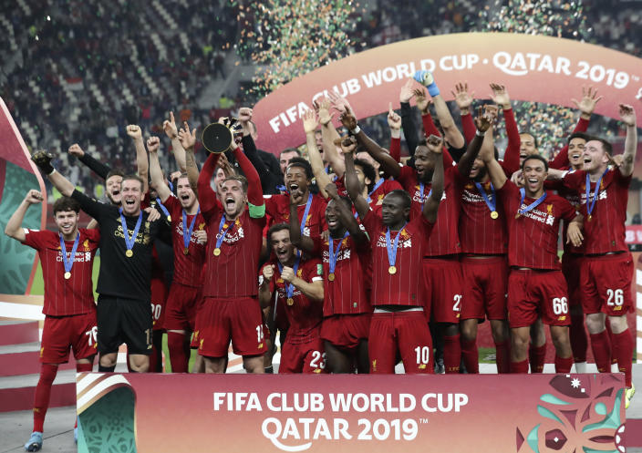 Players of Liverpool celebrate after winning the Club World Cup final soccer match between Liverpool and Flamengo at Khalifa International Stadium in Doha, Qatar, Saturday, Dec. 21, 2019. (AP Photo/Hassan Ammar)