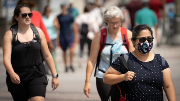 People walk through downtown Ottawa earlier this summer. Public health officials reported 55 new COVID-19 cases Sunday, the highest one-day total since early June. (Brian Morris/CBC - image credit)