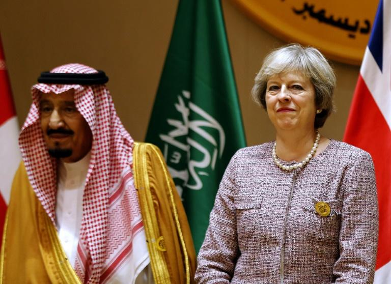 British Prime Minister Theresa May, here shown with Saudi King Salman at a Gulf Cooperation Council (GCC) summit on December 7, 2016 in Bahrain, heads to Saudi Arabia on Tuesday