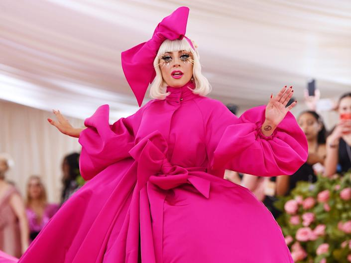 lady gaga attends the met gala in 2019 wearing pink ballgown and headpiece