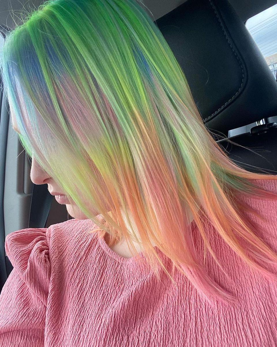 """""""Right now, we're seeing a lot of rainbow hair as people are more inclined to experiment, since many are staying at home,"""" says Friedman. """"Just the other day, I saw a woman around 60 years old with multicolored, bright and beautiful hair, and she looked absolutely fabulous."""" While any color goes, she's particularly into a mix of shades right now, which can be a little harder to do yourself at home. """"Bring examples to your stylist to show exactly what you're thinking,"""" says Friedman. """"From an inspiration photo to a scarf you look great in, showing your stylist your ideal color palette will help them create a look that's perfectly suited and unique to you."""" To preserve the bright colors, use a dry shampoo, and wash as few times a week as possible."""