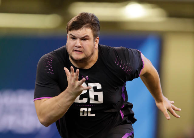 FILE - In this March 2, 2018, file photo, Notre Dame offensive lineman Quenton Nelson runs a drill at the NFL football scouting combine in Indianapolis. Nelson is expected to be a first round pick in the NFL Draft.(AP Photo/Michael Conroy, Com)