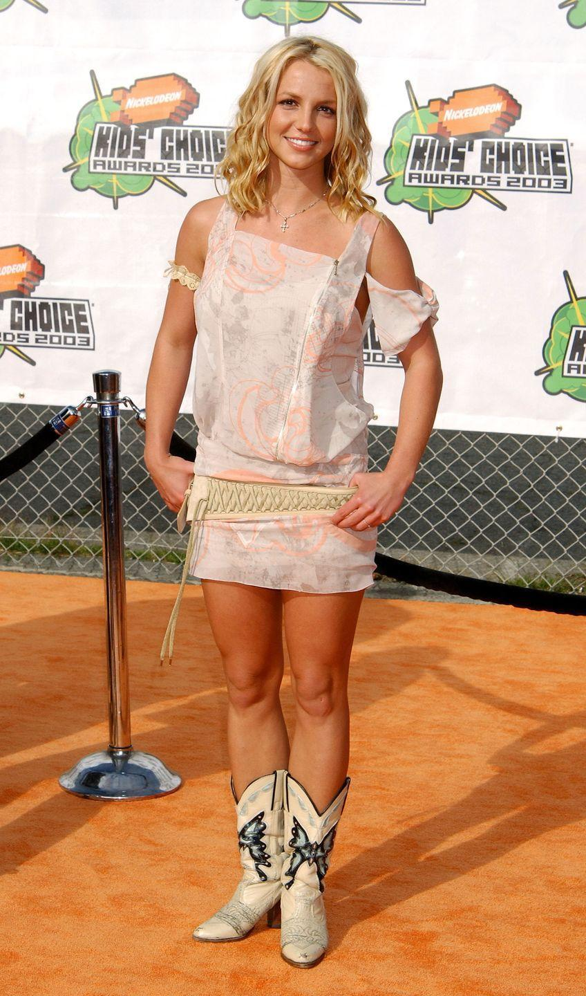 <p>Here's Britney in some more fab cowboy boots and a cold-shoulder floral dress with a lace-up belt. You're so welcome.</p>