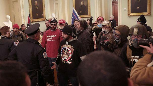 PHOTO: Protesters interact with Capitol Police inside the U.S. Capitol Building on Jan. 6, 2021, in Washington, D.C., after they breached the building while a joint session to certify the electoral college votes was taking place. (Win McNamee/Getty Images)
