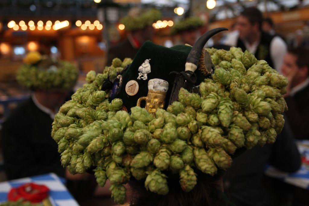 A hat decorated with hops, the key ingredient in making beer, does the rounds at the opening day of the Oktoberfest 2012 beer festival in Munich, Germany.