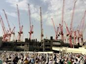 Construction cranes in Saudi Arabia's holy city of Mecca, pictured in 2015; the Bin Laden Group is the kingdom's biggest construction company and has been involved in key infrastructure projects