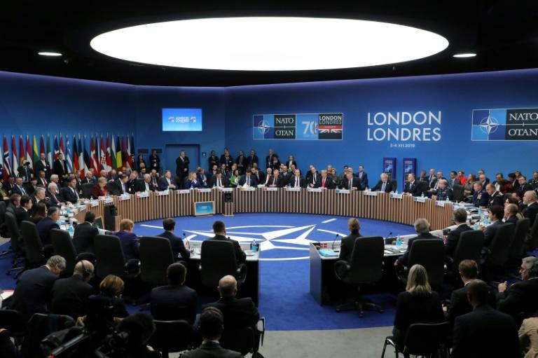 Amid the differences, NATO Secretary General Jens Stoltenberg opened the sole summit working session hailing increased European and Canadian defence spending (AFP Photo/ludovic MARIN)