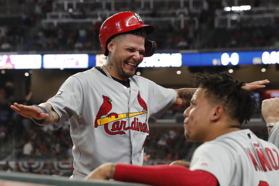 St. Louis Cardinals catcher Yadier Molina celebrates in the ninth inning during Game 1 of a best-of-five National League Division Series agaimnst the Atlanta Braves, Thursday, Oct. 3, 2019, in Atlanta. (AP Photo/John Bazemore)