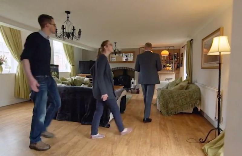 Sam and husband Andy follow Phil Spence into the living room