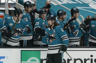 San Jose Sharks defenseman Erik Karlsson, foreground, celebrates with teammates after scoring a goal against the Colorado Avalanche during the third period of an NHL hockey game in San Jose, Calif., Monday, March 1, 2021. (AP Photo/Jeff Chiu)