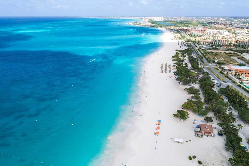 Aerial view of a resort-lined beach in Aruba