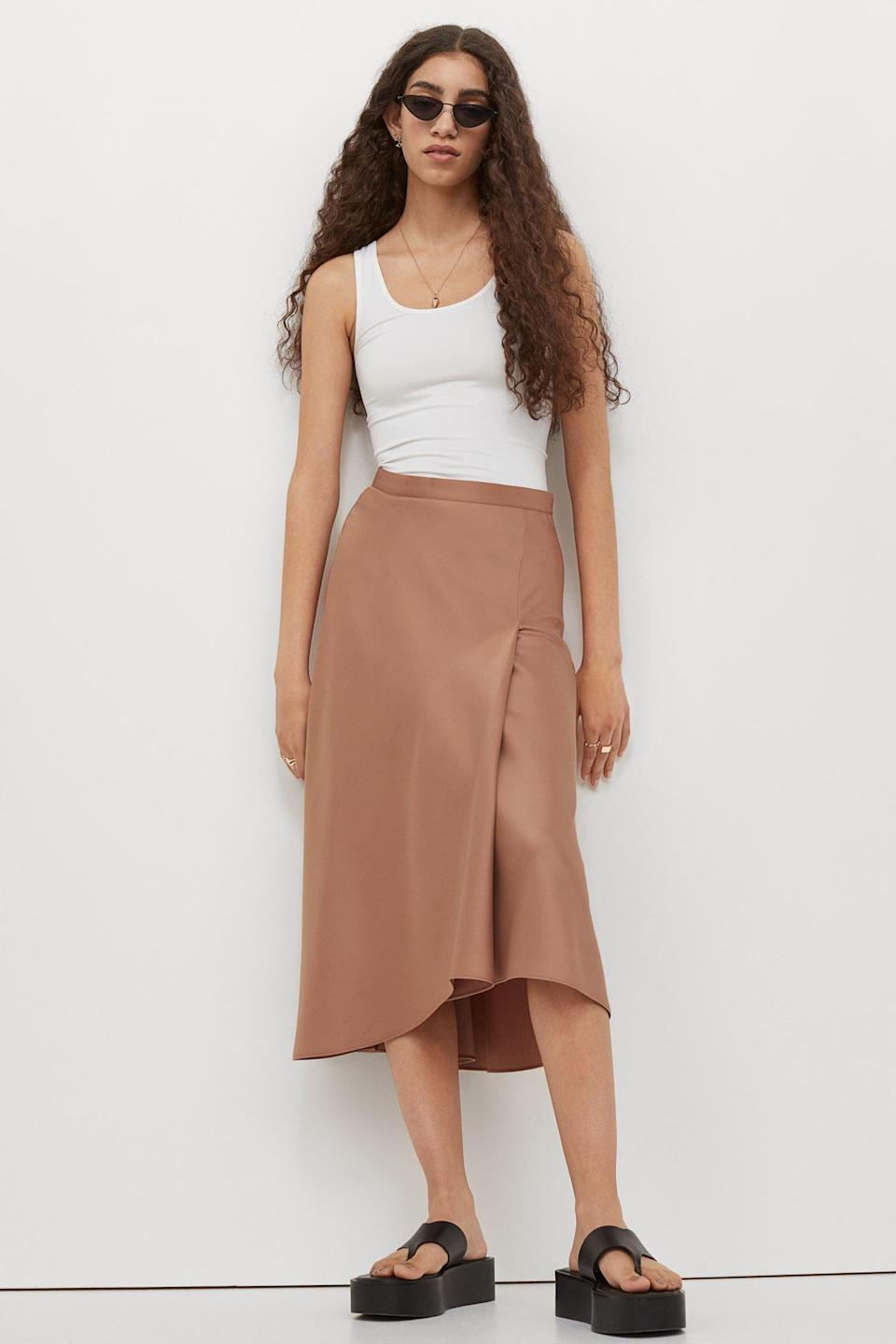 <p>This <span>Calf-length Satin Skirt</span> ($35) will look great with a tank top, a crop top, a blouse, and basically any top in your closet.</p>