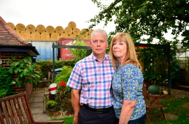 <em>Andrew and Gillian Dale can see the hay stacked up behind their property (SWNS)</em>