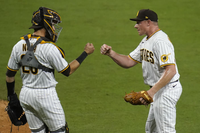 San Diego Padres relief pitcher Mark Melancon, right, celebrates with catcher Austin Nola after the Padres defeated the Pittsburgh Pirates 2-0 in a baseball game Monday, May 3, 2021, in San Diego. (AP Photo/Gregory Bull)