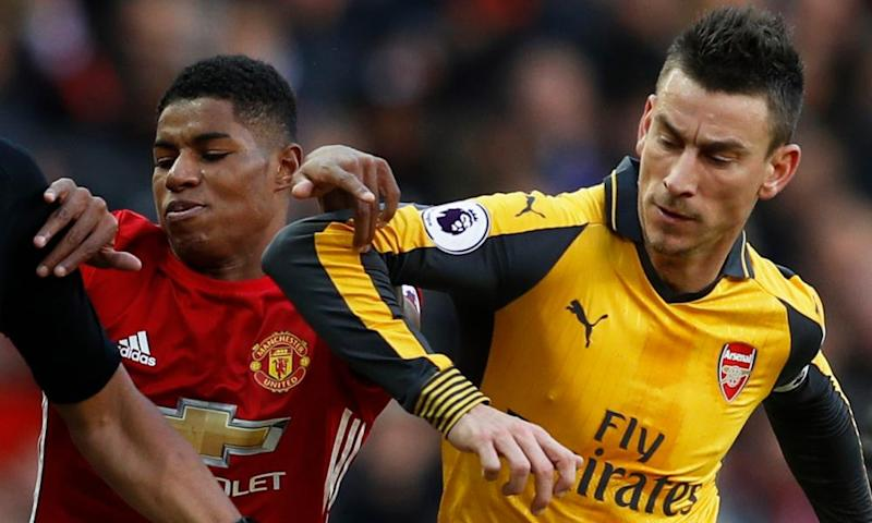 Manchester United's Marcus Rashford and Arsenal's Laurent Koscielny collide during the team's meeting at Old Trafford earlier this season.