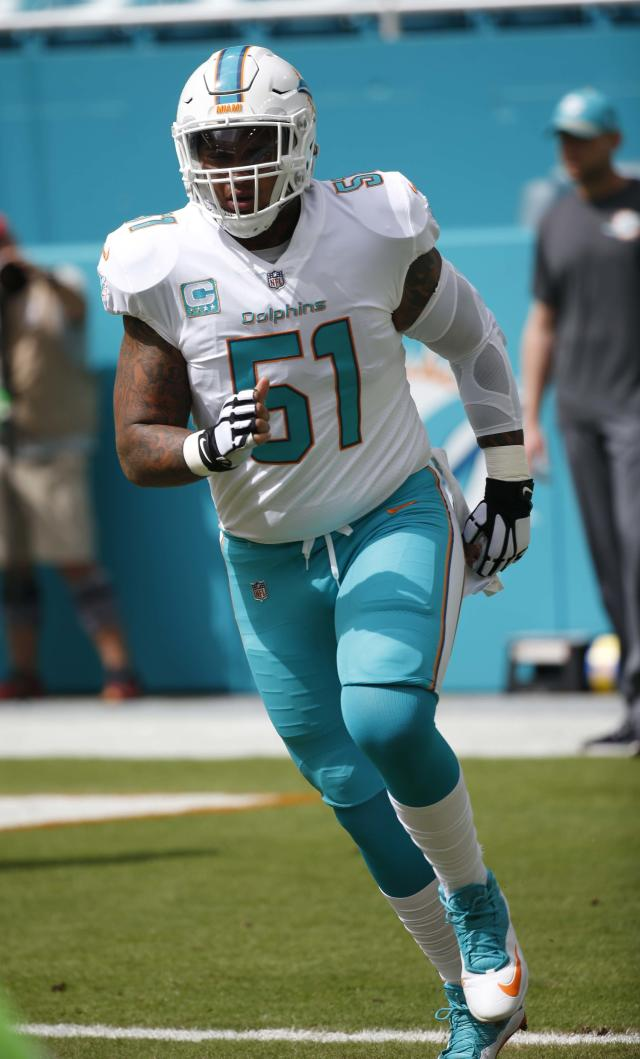 Miami Dolphins center Mike Pouncey (51) warms up before an NFL football gam against the New York Jets, Sunday, Oct. 22, 2017, in Miami Gardens, Fla. (AP Photo/Wilfredo Lee)