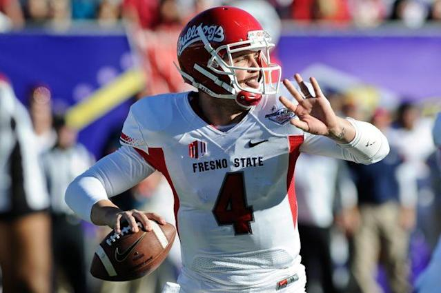 "<a class=""link rapid-noclick-resp"" href=""/nfl/players/27564/"" data-ylk=""slk:Derek Carr"">Derek Carr</a> will be the seventh player in Fresno State history to have his number retired. (AP Photo/David Cleveland)"