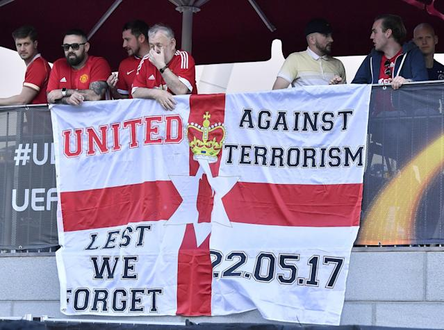 <p>Supporters stay behind a flag outside the stadium prior to the soccer Europa League final between Ajax Amsterdam and Manchester United at the Friends Arena in Stockholm, Sweden, Wednesday, May 24, 2017. (AP Photo/Martin Meissner) </p>