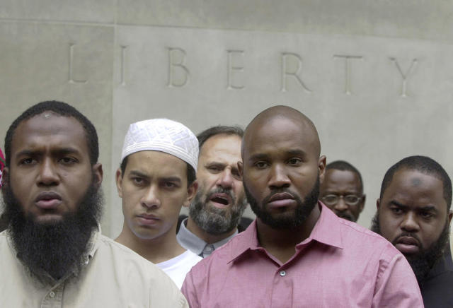 <p>Men listen to a speaker at a protest held by leaders of local mosques in front of the federal courthouse in Philadelphia, June 11, 2004. (Photo: Jacqueline Larma/AP) </p>