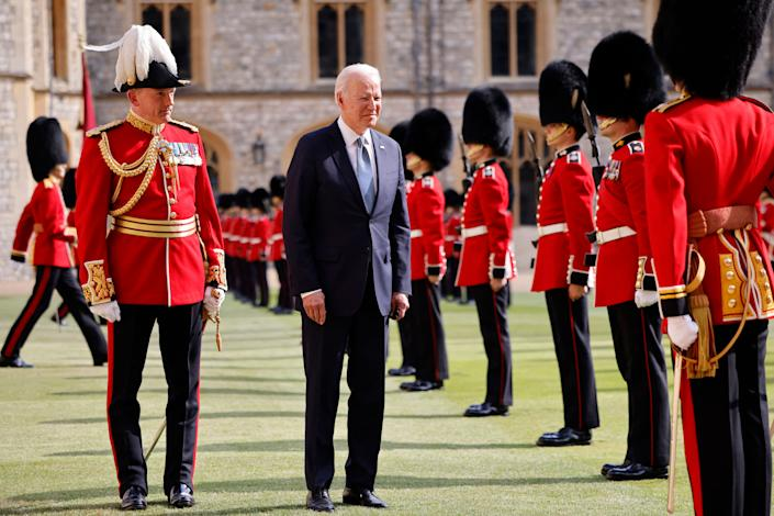 US President Joe Biden (C) joins the Major General Christopher Ghika (L) in inspecting the Guard of Honour formed of The Queen's Company First Battalion Grenadier Guards at Windsor Castle in Windsor, west of London, on June 13, 2021. - US president Biden will visit Windsor Castle late Sunday, where he and First Lady Jill Biden will take tea with the queen. (Photo by Tolga Akmen / AFP) (Photo by TOLGA AKMEN/AFP via Getty Images)