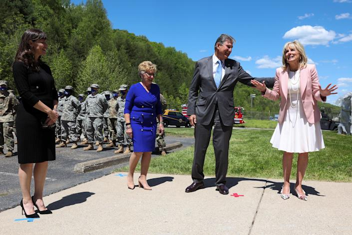 US First Lady Jill Biden greets members of the West Virginia National Guard with Senator Joe Manchin, his wife Gayle and actor Jennifer Garner during a trip to Charleston, W.V. on May 13, 2021.   (Oliver Contreras/Pool via REUTERS)