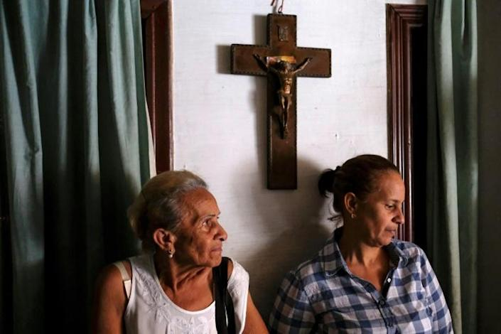 Esperanza Castillo, 74, waits for treatment at the clinic with her daughter (AFP Photo/Matias Delacroix)
