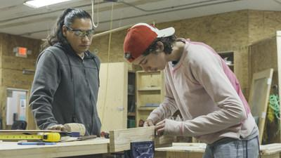 Core Neighbourhood Youth Co-op (CNYC) instructor Ace Lafond (left) provides woodworking tips to student Gage Ritchie-Nadeau. The local organization recently received a multi-year grant from The Co-operators Community Funds to help support its programming for marginalized youth. (CNW Group/The Co-operators)