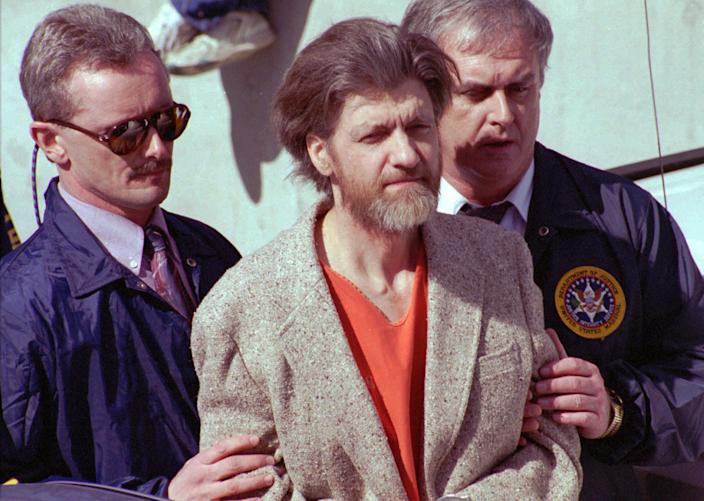 Theodore John Kaczynski is flanked by federal agents as he is led to a car from the federal courthouse in Helena, Mont., April 4, 1996. (John Youngbear/AP)