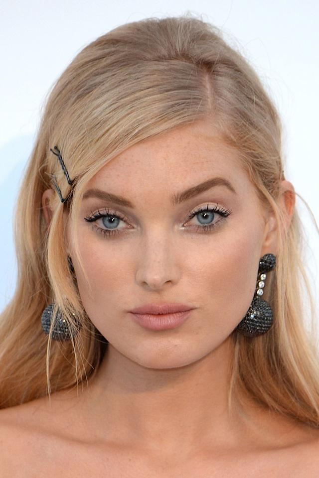 "<p>Hosk added herself to the list of celebrities bringing back <a rel=""nofollow"" href=""http://www.harpersbazaar.co.uk/beauty/beauty-shows-trends/news/a41658/hair-accessories-cool-again/"">90s hair accessories</a> by styling her deep side-part with black hair slides.</p>"