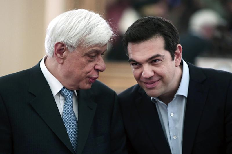 The head of state, President Prokopis Pavlopoulos (L), is expected to name a caretaker government on August 28, 2015 and announce an election date, following the resignation of Prime Minister Alexis Tsipras (R) (AFP Photo/Angelos Tzortzinis)